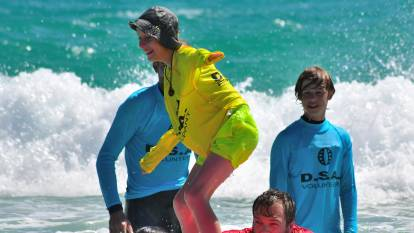 Disabled surfers ride waves at Bunker Bay