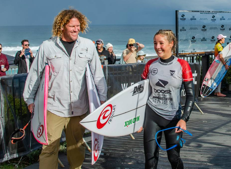 Willow Hardy at Surfers Point with dad Gene; The talented young surfer was mobbed by fans and friends who gathered at the point to witness her compete against some of the world's finest surfers. Photos: Thea McDonald-Lee